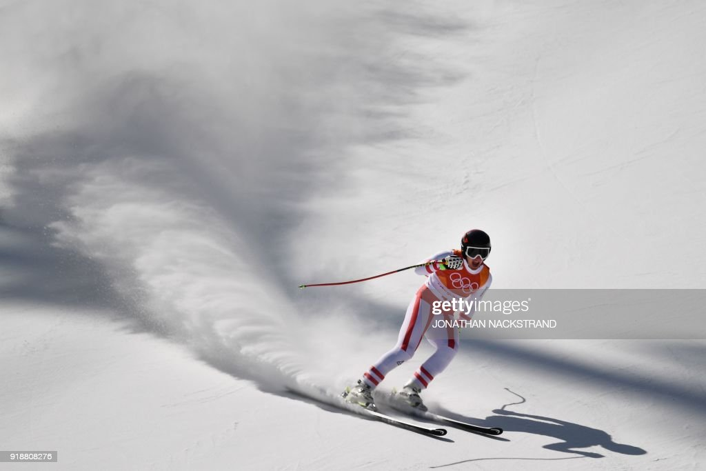 TOPSHOT - Austria's Matthias Mayer competes in the Men's Super G at the Jeongseon Alpine Center during the Pyeongchang 2018 Winter Olympic Games in Pyeongchang on February 16, 2018. / AFP PHOTO / Jonathan NACKSTRAND