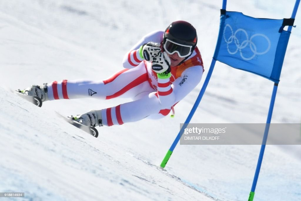 TOPSHOT - Austria's Matthias Mayer competes in the Men's Super G at the Jeongseon Alpine Center during the Pyeongchang 2018 Winter Olympic Games in Pyeongchang on February 16, 2018. / AFP PHOTO / Dimitar DILKOFF