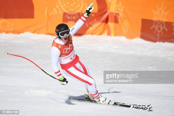 TOPSHOT Austria's Matthias Mayer crosses the finish line of the Men's Super G at the Jeongseon Alpine Center during the Pyeongchang 2018 Winter...