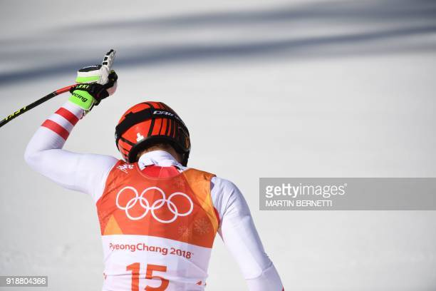 TOPSHOT Austria's Matthias Mayer reacts after crossing the finish line of the Men's Super G at the Jeongseon Alpine Center during the Pyeongchang...