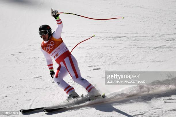 Austria's Matthias Mayer reacts after crossing the finish line of the Men's Super G at the Jeongseon Alpine Center during the Pyeongchang 2018 Winter...