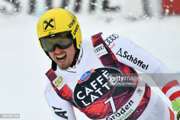 Austria's Max Franz reacts after crossing the finish line of the FIS Alpine World Cup Men Super G on December 15 2017 in Val Gardena Groeden Italian...
