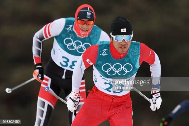 Austria's Max Hauke and Japan's Keishin Yoshida compete in the men's 15km 15km crosscountry skiathlon at the Alpensia cross country ski centre during...