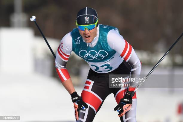 Austria's Max Hauke competes during the men's 15km cross country freestyle at the Alpensia cross country ski centre during the Pyeongchang 2018...