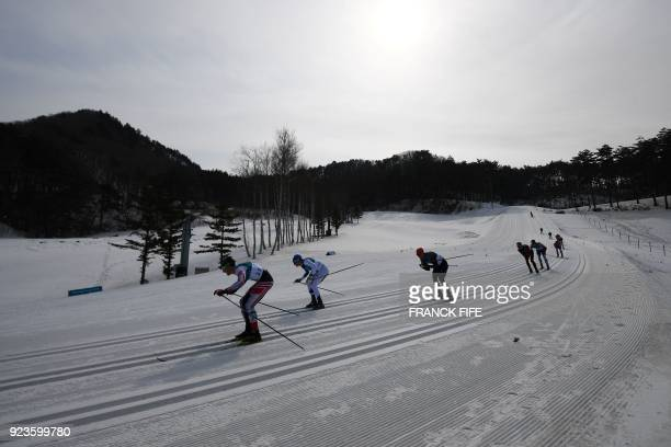 Austria's Max Hauke competes during the men's 50km cross country mass start classic at the Alpensia cross country ski centre during the Pyeongchang...