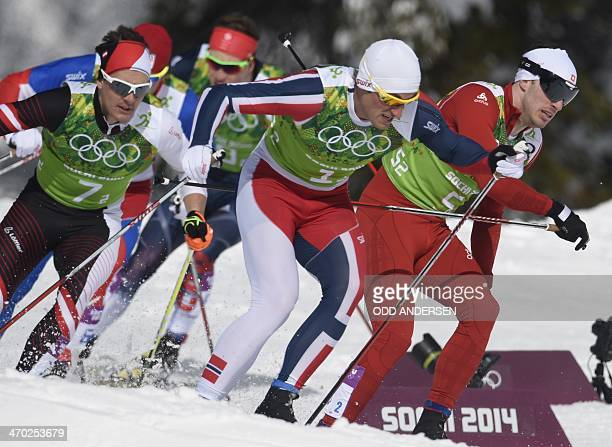 Austria's Max Hauke Norway's Petter Jr Northug and Switzerland's Gianluca Cologna compete in the Men's CrossCountry Skiing Team Sprint Classic...
