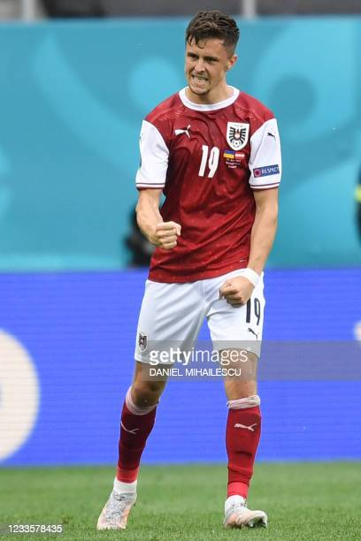 Austria's midfielder Christoph Baumgartner celebrates after scoring the opening goal during the UEFA EURO 2020 Group C football match between Ukraine...