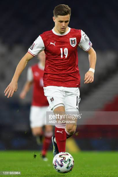 Austria's midfielder Christoph Baumgartner runs with the ball during the FIFA World Cup Qatar 2022 qualification football match between Scotland and...