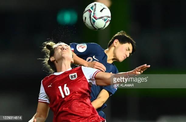 Austria's midfielder Jasmin Eder and France's midfielder Elisa De Almeida vie for the ball during the UEFA Women's Euro 2021 Group G qualifying...