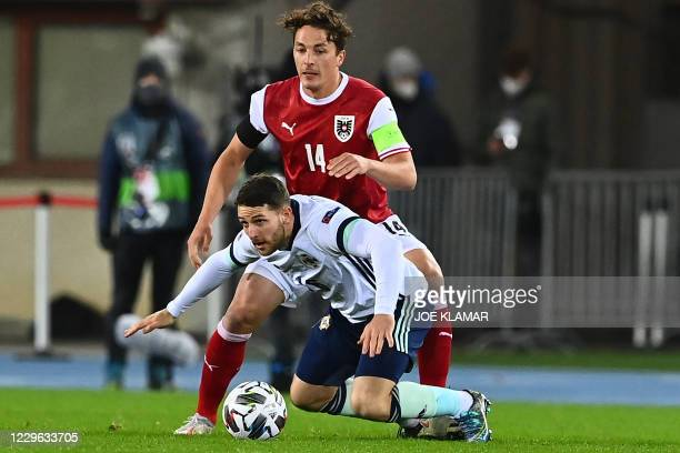 Austria's midfielder Julian Baumgartlinger and Northern Ireland's forward Conor Washington vie for the ball during the UEFA Nations League football...