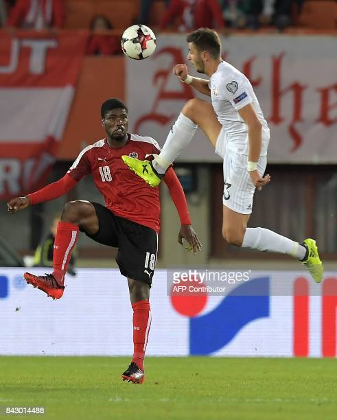 Austria's midfielder Kevin Danso and Georgia's golkeeper Giorgi Kvilitaia vie for the ball during the Group D FIFA World Cup 2018 qualification match...