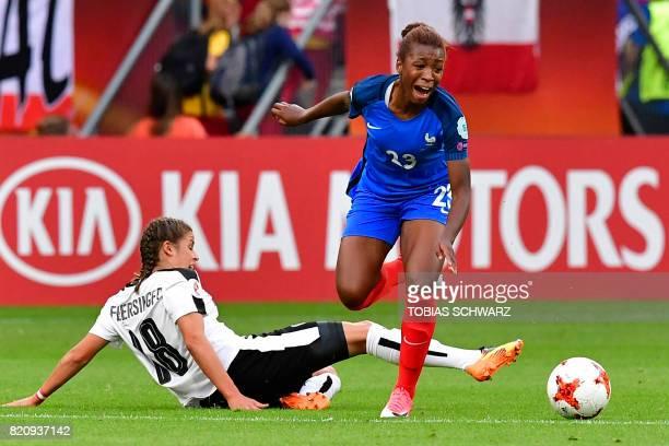 Austria's midfielder Laura Feiersinger tackles France's midfielder Onema Grace Geyoro during the UEFA Women's Euro 2017 football tournament between...