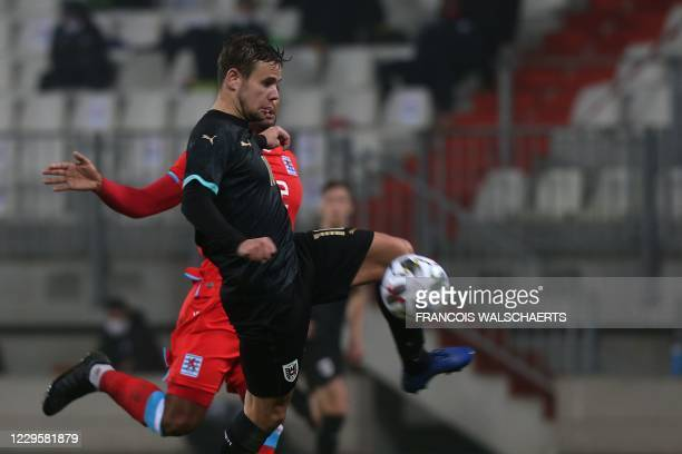 Austria's midfielder Louis Schaub controls the ball during the friendly football match between Luxembourg and Austria at the Josy Barthel Stadium in...