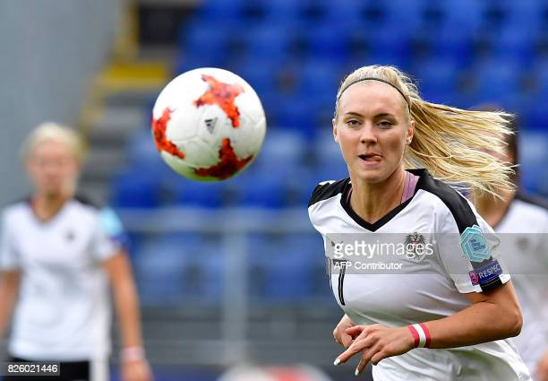 Austria's midfielder Sarah Puntigam eyes the ball during the UEFA Womens Euro 2017 football tournament semifinal match between Denmark and Austria at...