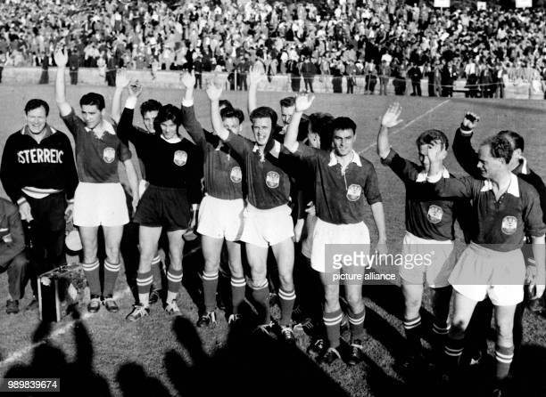 Austria's national football team is celebrating the end of a successful 3rd place match waving and greeting Austria wins the 1954 FIFA World Cup 3rd...