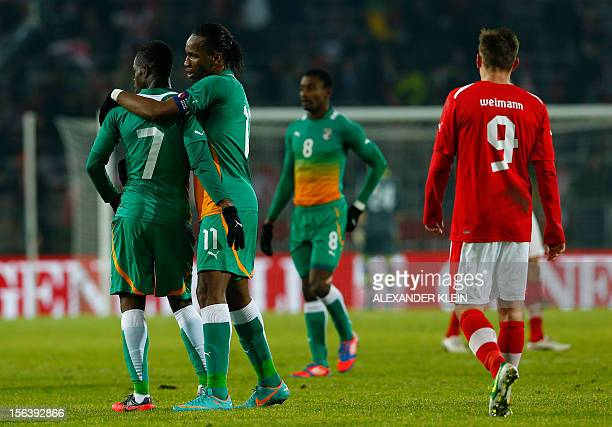 Austria's national football team player Andreas Weimann looks on as Ivory Coast's national football team players Abdul Razak and Didier Drogba...