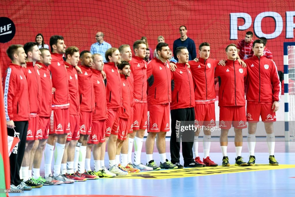 Austria's national team players listen to the national anthem prior to the preliminary round group B match of the Men's 2018 EHF European Handball Championship between Belarus and Austria in Porec, Croatia on January 12, 2018. /