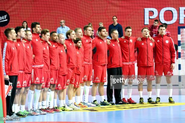 Austria's national team players listen to the national anthem prior to the preliminary round group B match of the Men's 2018 EHF European Handball...