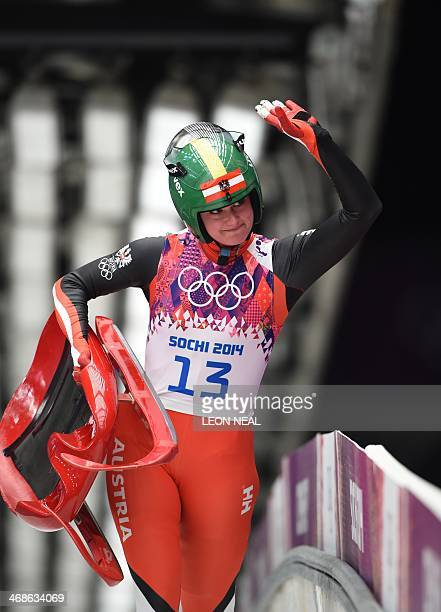 Austria's Nina Reithmayer gestures after her run 3 of the Women's Luge Singles event of the Sochi Winter Olympics on February 11 2014 at the Sanki...