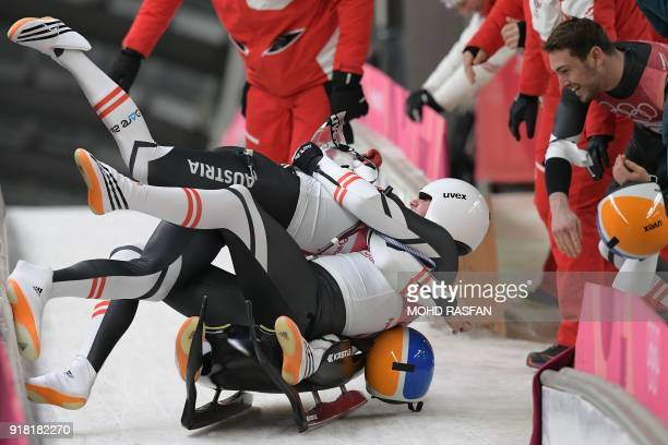 Austria's Peter Penz and Georg Fischler compete in the doubles luge run 2 final during the Pyeongchang 2018 Winter Olympic Games at the Olympic...