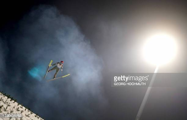 Austria's Philipp Aschenwald soars through the air during a qualification jump of the fourth event of the Four-Hills Ski Jumping tournament in...