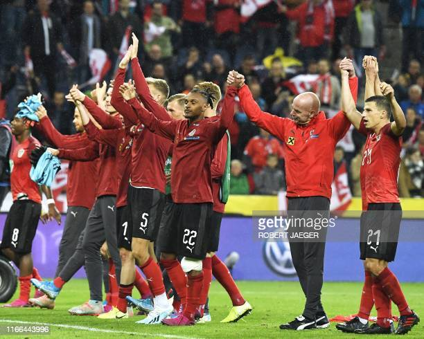 Austria's players celebrate after the UEFA Euro 2020 qualification football match between Austria and Latvia in Salzburg Austria on September 6 2019...