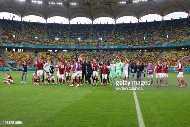 Austria's players celebrate after winning the UEFA EURO 2020 Group C football match between Ukraine and Austria at the National Arena in Bucharest on...