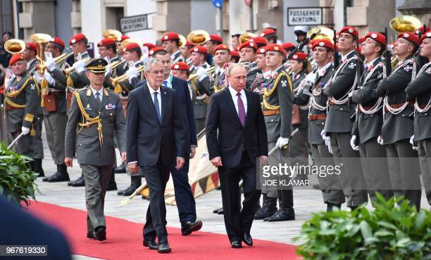 Austria's President Alexander van der Bellen and Russian President Vladimir Putin inspect a military honor guard at the Presidential palace in Vienna...