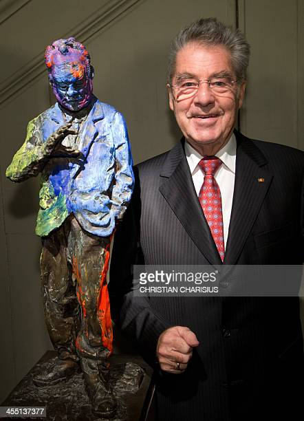 Austria's President Heinz Fischer poses next to the bronze sculpture titled Willy Brandt The Small Sculpture by German artist Rainer Fetting at the...