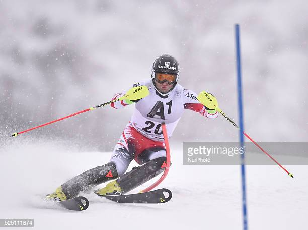 Austria's Reinfried Herbst races down the course during the men's Slalom on the third day of the famous Hahnenkamm at the FIS SKI World Cup in...