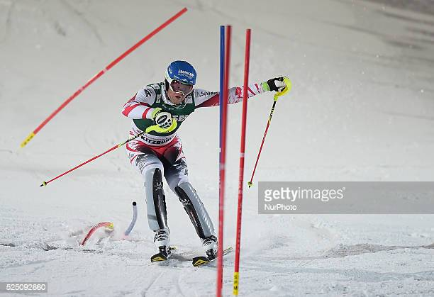 Austria's Romed Baumann, races down the famous Hahnenkamm course during the men's Alpine Combined - Slalom, at the FIS SKI World Cup in Kitzbuehel....