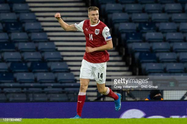 Austria's Sasa Kalajdzic celebrates his first goal during a World Cup qualifier between Scotland and Austria at Hampden Park, on March 25 in Glasgow,...