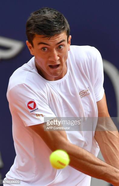 Austria's Sebastian Ofner returns a ball to Uruguay's Pablo Cuevas at the ATP General Open Kitzbuehel Tennis Tournament on August 1 2017 in Kitzbühel...