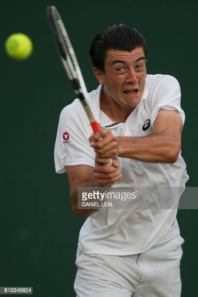 Austria's Sebastian Ofner returns against US player Jack Sock during their men's singles second round match on the fourth day of the 2017 Wimbledon...