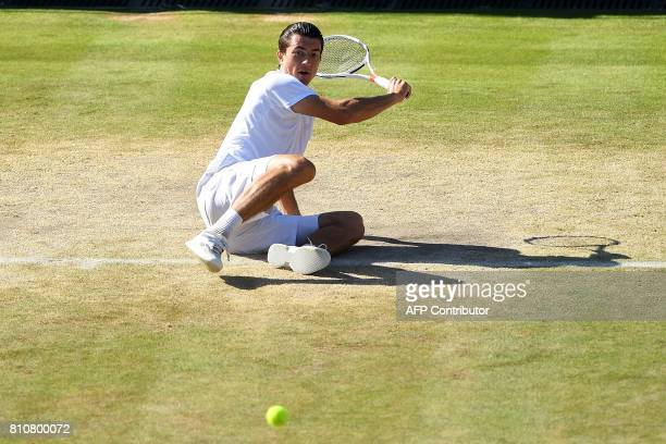 Austria's Sebastian Ofner returns to Germany's Alexander Zverev during their men's singles third round match on the sixth day of the 2017 Wimbledon...
