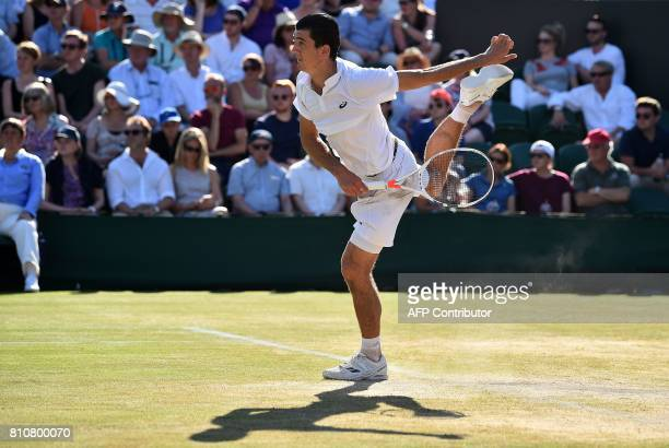 Austria's Sebastian Ofner serves to Germany's Alexander Zverev during their men's singles third round match on the sixth day of the 2017 Wimbledon...
