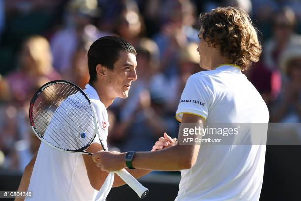 Austria's Sebastian Ofner shakes hands with Germany's Alexander Zverev after losing their men's singles third round match on the sixth day of the...