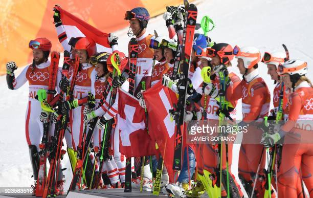 Austria's second place winners Marco Schwarz Michael Matt Manuel Feller Katharina Liensberger Katharina Gallhuber and Stephanie Brunner Switzerland's...