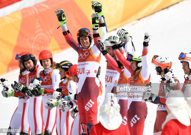Austria's second place winners Marco Schwarz Michael Matt Manuel Feller Katharina Liensberger Katharina Gallhuber and Stephanie Brunner pose on the...