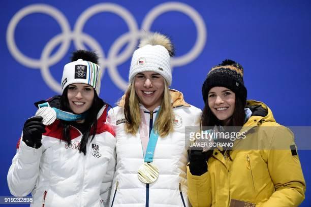 Austria's silver medallist Anna Fenninger Veith Czech Republic's gold medallist Ester Ledecka and Liechtenstein's bronze medallist Tina Weirather...