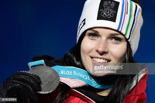 Austria's silver medallist Anna Fenninger Veith poses on the podium during the medal ceremony for the alpine skiing women's SuperG at the Pyeongchang...