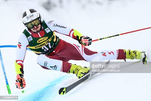 Austria's Stefan Brennsteiner competes during the first run of the 3rd Men's Giant Slalom event of the FIS Alpine Ski World Cup, in Santa Caterina di...