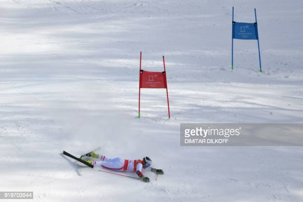 Austria's Stefan Brennsteiner falls while competing in the Men's Giant Slalom at the Jeongseon Alpine Center during the Pyeongchang 2018 Winter...