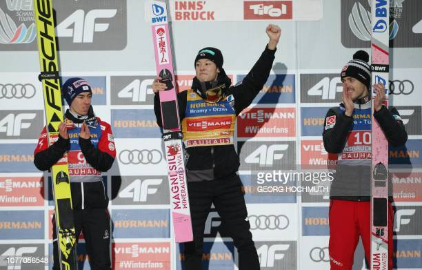 Austria's Stefan Kraft Japan's Ryoyu Kobayashi and Norway's Andreas Stjernen celebrate on the podium after the third stage of the FourHills Ski...