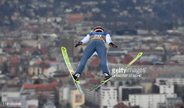 Austria's Stefan Kraft soars through the air during his second training jump at the FourHills Ski Jumping tournament in GarmischPartenkirchen...