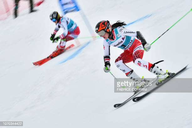 Austria's Stephanie Brunner and Austria's Katharina Huber compete in the first run of the round of 32 of the Women's parallel slalom race during the...