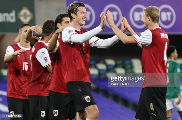 Austria's striker Michael Gregoritsch celebrates scoring his team's first goal with Austria's defender Martin Hinteregger during the UEFA Nations...