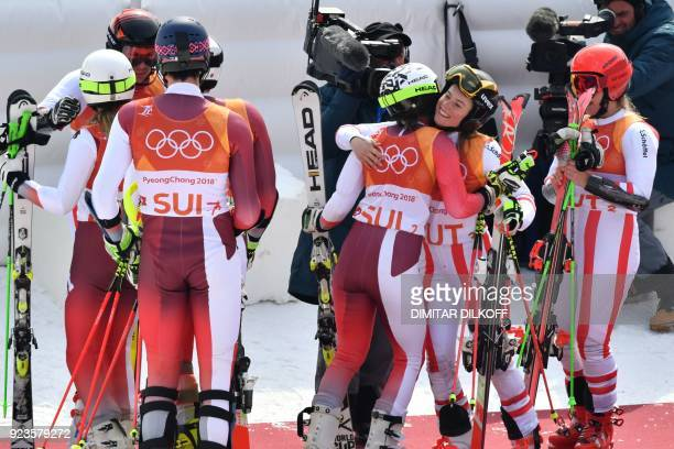 Austria's team congratulate Switzerland's team after the Alpine Skiing Team Event big final at the Jeongseon Alpine Center during the Pyeongchang...