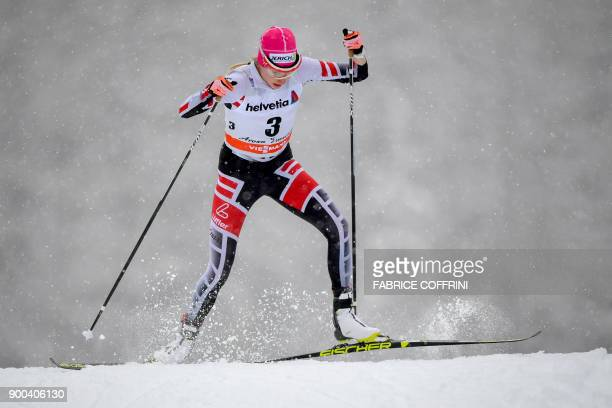 Austria's Teresa Stadlober competes in the Women's 15 km Sprint Free qualification during the cross country FIS World cup Tour de Ski event on...