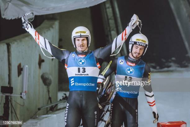 Austria's Thomas Steu and Lorenz Koller celebrate after winning the overall double men's sprint competition of the Luge World Cup at the Olympia...